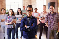 Portrait Of Staff Standing In Modern Design Office Royalty Free Stock Image