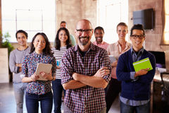 Portrait Of Staff Standing In Modern Design Office Stock Photos