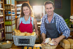 Portrait of staff working at bakery counter. In supermarket Stock Image