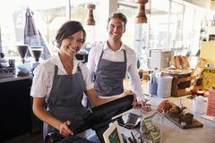 Portrait Of Staff Working At Delicatessen Checkout Royalty Free Stock Photography
