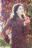 Portrait of standing autumn girl in fall head wreath with red apple in arm Royalty Free Stock Images
