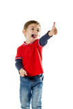 Portrait of a standing boy with thumb up Royalty Free Stock Images