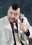 Portrait standing mafia boss showing thumbs Stock Photo