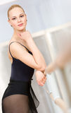 Portrait of standing near barre ballerina Royalty Free Stock Photo