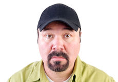 Portrait of staring man wearing baseball cap Stock Images