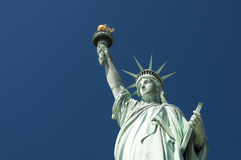 Portrait of the Statue of Liberty against Bright Blue Sky Royalty Free Stock Photo