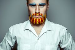 Portrait Of A Stern Man With beard, Unraveled In Colors Of The Flag Of Catalonia. Referendum In Catalonia Stock Images