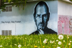 Portrait of Steve Jobs made in the wall of a building Royalty Free Stock Photo