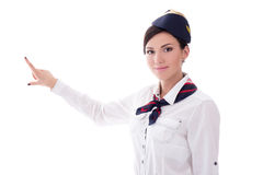 Portrait of stewardess in uniform pointing at something isolated Royalty Free Stock Photo