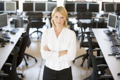 Portrait Of A Stock Trader. Portrait Of A Female Stock Trader With Crossed Arms stock photos