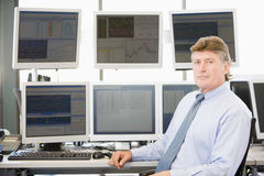 Portrait Of Stock Trader In Front Of Computer. Monitors stock photo