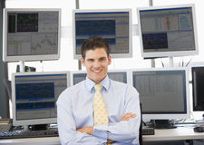 Portrait Of Stock Trader In Front Of Computer. Monitors stock photography