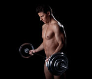 Portrait of strained athlete lifting rod Royalty Free Stock Photos