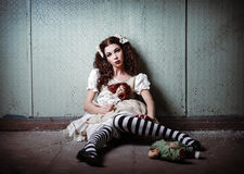 Portrait of strange lonely girl with dolls in abandoned place. Portrait of a strange lonely girl with dolls in abandoned place stock image