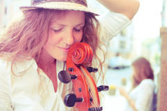 Portrait of street musician woman Royalty Free Stock Photo