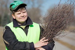 Portrait street sweeper in city park. Portrait positive street sweeper in city park with broom tool Royalty Free Stock Photos