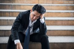 Portrait of stress desperate senior businessman. Sitting on stair with sad feeling after not to get bonus and promotion. KPI not meet and business project Stock Photography