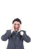 Portrait of stressed businessman screaming in pain and having he stock photography