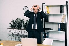 portrait of stressed businessman in suit standing at workplace royalty free stock images
