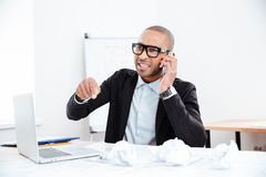 Portrait of a stressed businessman talking on phone Stock Photos