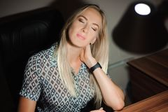 Portrait of stressed businesswoman sitting at office desk royalty free stock photography