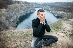 Portrait of stressed despair man closed face by two hands Royalty Free Stock Photography