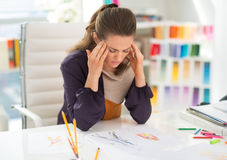 Portrait of stressed fashion designer in office. Portrait of stressed fashion designer in modern office royalty free stock image