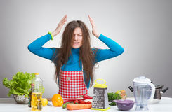 Portrait of a stressed housewife in the kitchen Royalty Free Stock Photos
