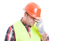 Portrait of stressed male builder looking upset Stock Images