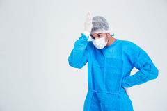 Portrait of a stressed male surgeon. Standing isolated on a white background Stock Images