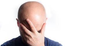 Portrait of a stressed Sad bald man on white background, coverin. G eyes with hands, hair loss baldness, headache, Shame, drowsiness Stock Images