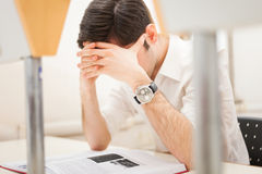 Stressed student reading a book Stock Photos