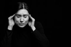 Portrait of stressed woman. Black and white portrait of stressed woman holding temples, isolated on white background Stock Image