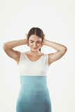 Portrait of a stressed woman standing isolated on a white background Royalty Free Stock Photo