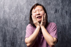Portrait of stressed young asian woman. Stock Photo