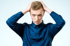 Portrait of stressed young man isolated Royalty Free Stock Photos