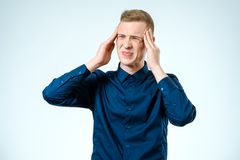 Portrait of stressed young man isolated Royalty Free Stock Photography