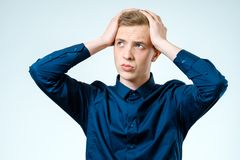 Portrait of stressed young man isolated Stock Photo