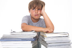 Portrait of a stressed young student with books Royalty Free Stock Photography