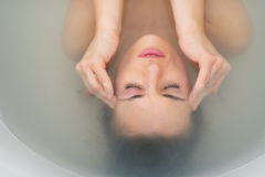 Portrait of stressed young woman in bathtub Stock Image