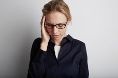 Portrait of stressed young woman in corporate office. Urban life style job related stress. Stock Photo