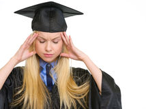 Portrait of stressed woman in graduation gown Royalty Free Stock Photo