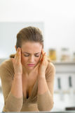 Portrait of stressed young woman in kitchen Royalty Free Stock Photography