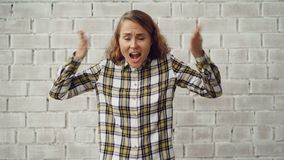 Portrait of stressed young woman screaming and gesturing expressing negative emotions then going away upset and angry stock footage