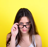 Portrait of strict young woman against yellow background Stock Image