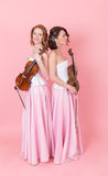Portrait of a string duo Royalty Free Stock Photo