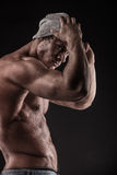 Portrait of strong Athletic Fitness man over black background royalty free stock photography