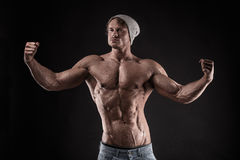 Portrait of strong Athletic Fitness man over black background stock photography