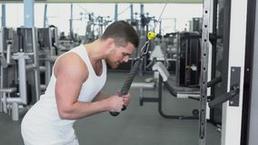 Portrait of strong athletic man at the gym training on block device Stock Photos