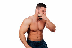 Portrait of a strong bearded male fitness model, torso. White background, isolate. hands on his hips. Portrait of a strong bearded male fitness model, torso Royalty Free Stock Photography
